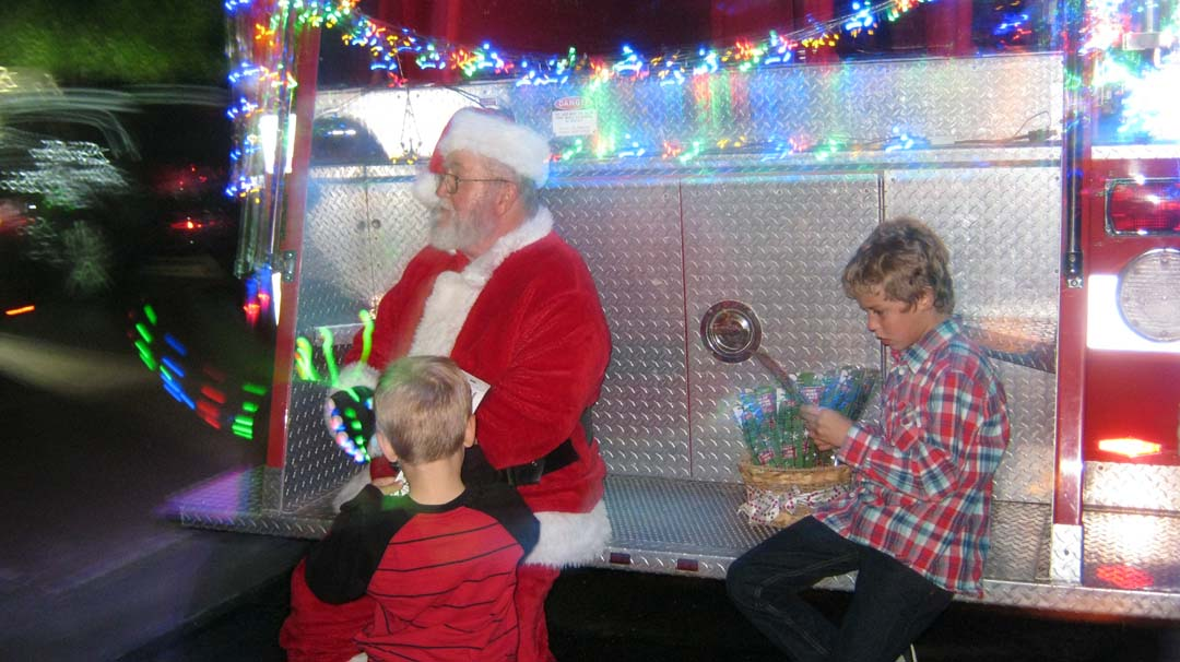 Santa on Back of Fire Truck